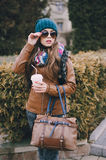 Beautiful fashion girls outdoor. Beautiful model walks through the city in a beautiful hat and glassesr stock photography