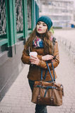 Beautiful fashion girls outdoor. Beautiful model walks through the city in a beautiful hat and glassesr stock photo