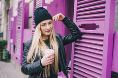 Beautiful fashion girls outdoor. Two beautiful girls walk around town fashionably and stylishly dressed with a Cup of coffee Stock Images