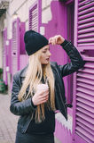 Beautiful fashion girls outdoor. Two beautiful girls walk around town fashionably and stylishly dressed with a Cup of coffee Stock Photo