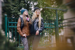 Beautiful fashion girls outdoor. Two beautiful girls walk around town fashionably and stylishly dressedr Royalty Free Stock Photography