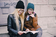Beautiful fashion girls outdoor. Two beautiful girls walk around town fashionably and stylishly dressedr stock photos