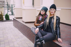 Beautiful fashion girls outdoor. Two beautiful girls walk around town fashionably and stylishly dressedr royalty free stock image