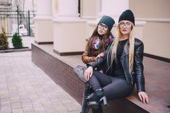Beautiful fashion girls outdoor. Two beautiful girls walk around town fashionably and stylishly dressedr Royalty Free Stock Image
