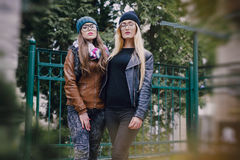 Beautiful fashion girls outdoor. Two beautiful girls walk around town fashionably and stylishly dressedr Stock Images