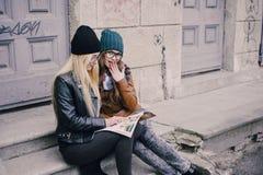 Beautiful fashion girls outdoor. Two beautiful girls walk around town fashionably and stylishly dressedr Stock Photo