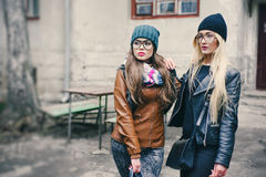 Beautiful fashion girls outdoor. Two beautiful girls walk around town fashionably and stylishly dressedr stock photography
