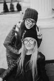 Beautiful fashion girls outdoor. Two beautiful girls walk around town fashionably and stylishly dressedr Royalty Free Stock Photo