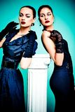 Beautiful fashion girls on the turquoise backgroun stock photography
