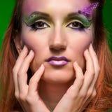 Beautiful fashion holiday multicolored makeup stock photo