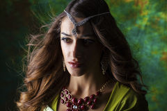 Beautiful fashion Indian woman portrait with oriental accessorie Royalty Free Stock Photo