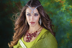 Beautiful fashion Indian woman portrait with oriental accessorie Royalty Free Stock Photos