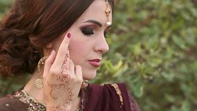 Portrait of Indian girls with kundan jewelry. stock footage