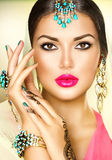Beautiful fashion Indian woman portrait. With oriental jewels Royalty Free Stock Photo