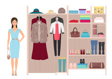 Beautiful fashion lady and women`s wardrobe. Vector women`s dressing room design. Clothes and shoes on hangers. Stock Photos