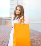 Beautiful fashion little girl with shopping bag Stock Images