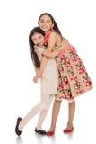 Beautiful fashion little girls sisters hugging Stock Photo