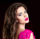 Beautiful Fashion Luxury Makeup, red lips, perfect skin fac. Ial make-up. Beauty Brunette model woman purple make up close up. Attractive girl model isolated on stock photography