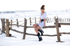 Beautiful fashion mode in winter. Picture of beautiful fashion model in winter farm Royalty Free Stock Photos