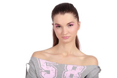 Beautiful fashion model. Front view of a beautiful young girl, dressed in a casual 58 t-shirt, wearing pink, natural make-up Royalty Free Stock Photo