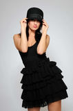 Beautiful fashion model in black dress Stock Photos