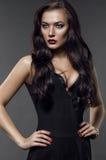 Beautiful Fashion model in black dress Royalty Free Stock Photography