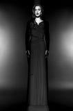 Beautiful Fashion model in black dress in studio Stock Photos