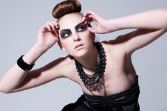 Beautiful fashion model with black make-up Stock Images
