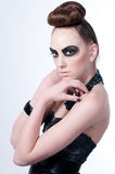 Beautiful fashion model with black make-up Royalty Free Stock Images