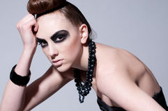 Beautiful fashion model with black make-up Royalty Free Stock Photos