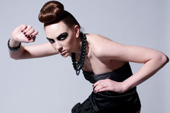 Beautiful fashion model with black make-up Stock Photos
