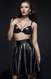 Beautiful Fashion model in black outfit Stock Photography
