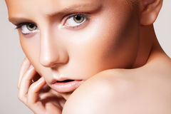 Beautiful fashion model with bronze tanned make-up Stock Photos