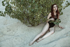 Beautiful fashion model in the desert. Royalty Free Stock Photos