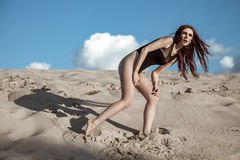 Beautiful fashion model in the desert. Stock Images