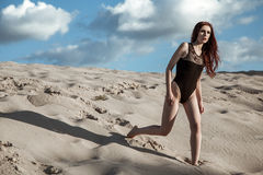 Beautiful fashion model in the desert. Royalty Free Stock Image