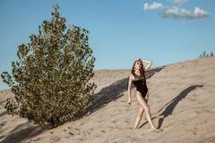 Beautiful fashion model in the desert. Stock Image