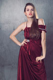 Beautiful fashion model in elegant red dress Stock Image