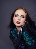 Beautiful fashion model with elegant make-up Stock Photography