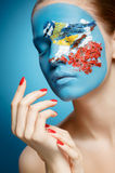 Beautiful fashion model with face art in winter style. royalty free stock photo