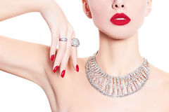 Beautiful and fashion model. Fashionable, beautiful model demonstrates jewelry Royalty Free Stock Photo