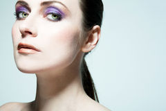 Beautiful fashion model with full make up. Royalty Free Stock Photo