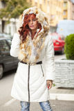 Beautiful Fashion Model In Fur Coat On Street Stock Photo