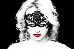 Beautiful fashion model girl with blond hair in mask. Royalty Free Stock Photos