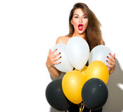 Beautiful fashion model girl with colorful balloons Royalty Free Stock Photos