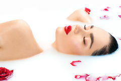 Beautiful fashion model girl taking milk bath, spa and skincare Royalty Free Stock Photography