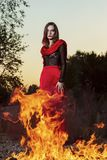 Beautiful fashion model girl wearing a red long skirt and a red stock images