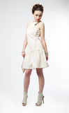 Beautiful fashion model girl in white dress posing Stock Images