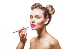 Beautiful fashion model girl whose makeup artist apply makeup, l Royalty Free Stock Image
