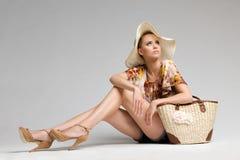 Beautiful fashion model in hat. Stock Photo